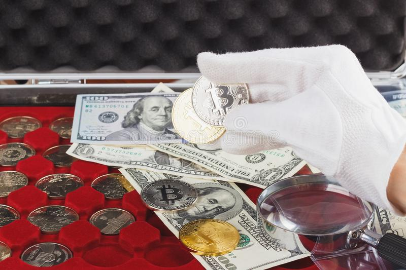 Hand in the white glove with gold and silver coins. Soft focus background royalty free stock images