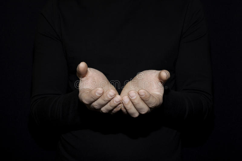Hand of white man open hand for holding object other mean is helping giving or beg concept on black background dark style royalty free stock images