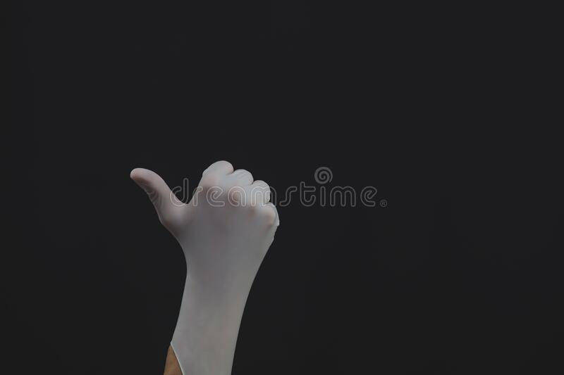 Hand in white medical glove shows thumbs up stock photos