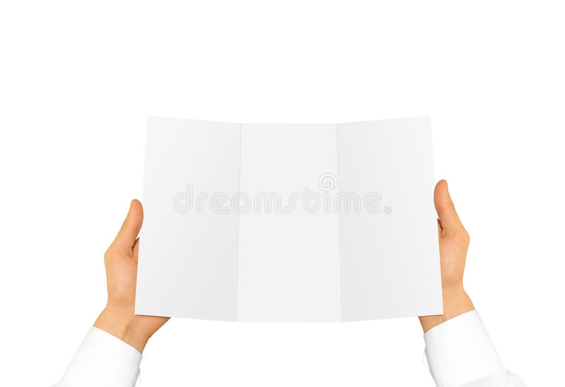 Hand in white shirt sleeve holding blank offset paper in the han. D. Empty leaflet presentation. Booklet hand man. Man show brochure mock up. Menu in hands stock photos