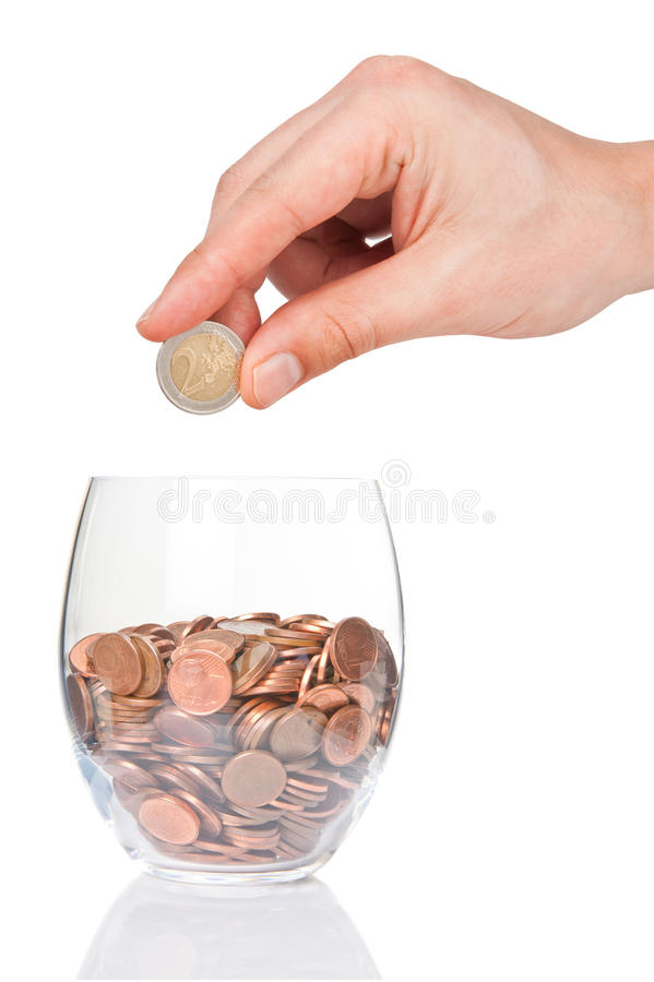 Free Hand With 2 Euro Coin And Glass With Euro Cents Stock Image - 51419861