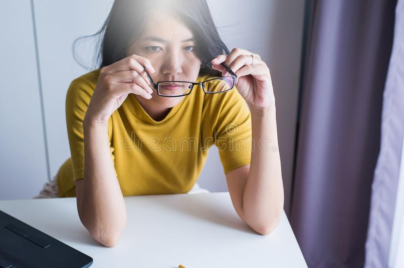 Hand woman cleaning her glasses with cloth,Clean lenses of eyeglasses stock photography