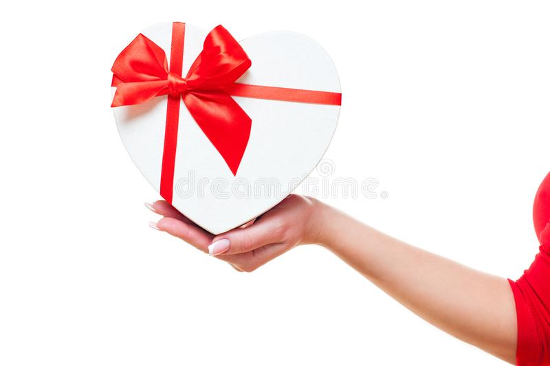 Hand of a woman and with gift box red heart-shaped, isolated on white background. valentines day theme. stock photos