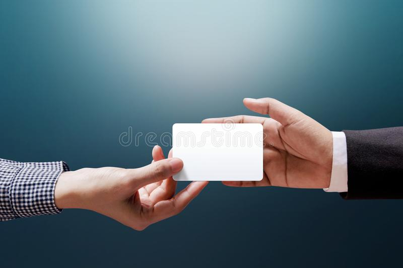 Hand of Woman giving a Blank Business Card to Businessman, Mockup White Card stock photos