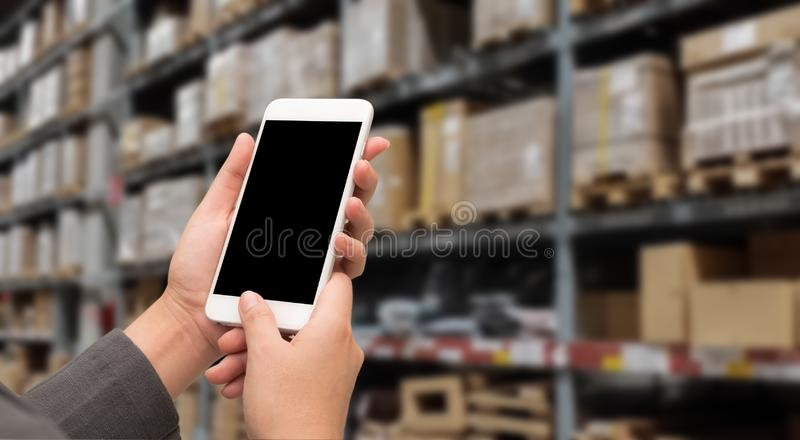 Hand woman holding smartphone to shopping online with blur storage background.  stock photo
