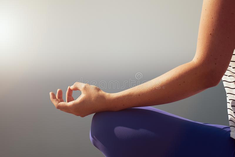 Hand of woman practicing meditation yoga stock images