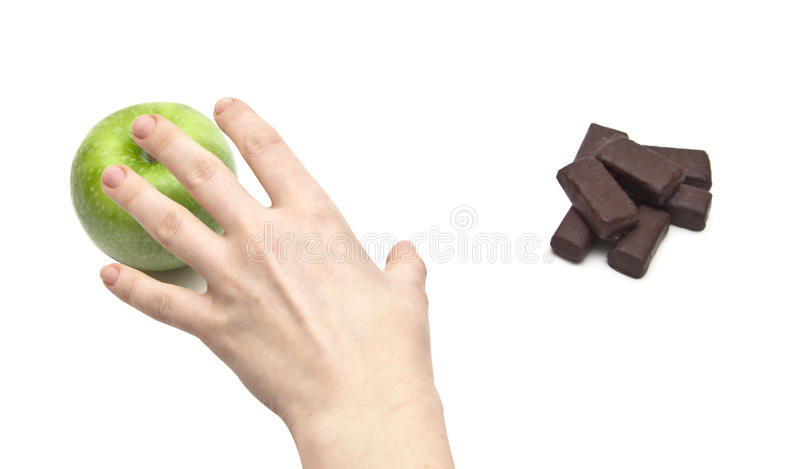 Download Hand Women Choosing Apple Against Chocolate Stock Photo - Image: 17520004