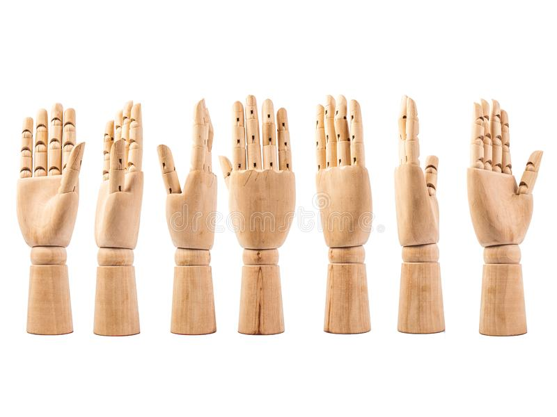 Hand of wood doll on white bakground stock photography
