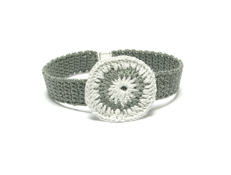 Hand worked crocheted collar. With white and grey crocheted ring stock photos