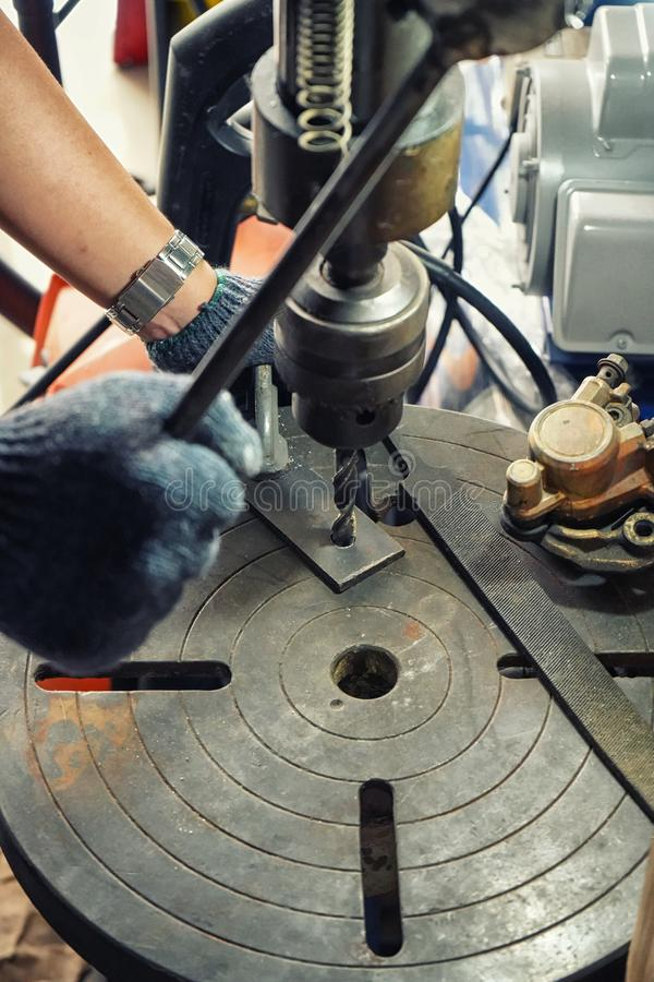 Hand of worker man using electric drill machine, stock image