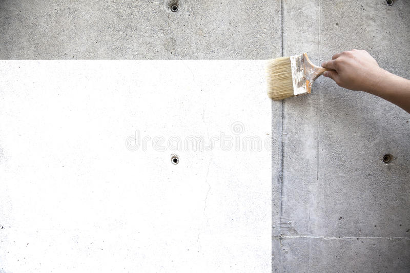 Hand of worker painting the old wall royalty free stock image