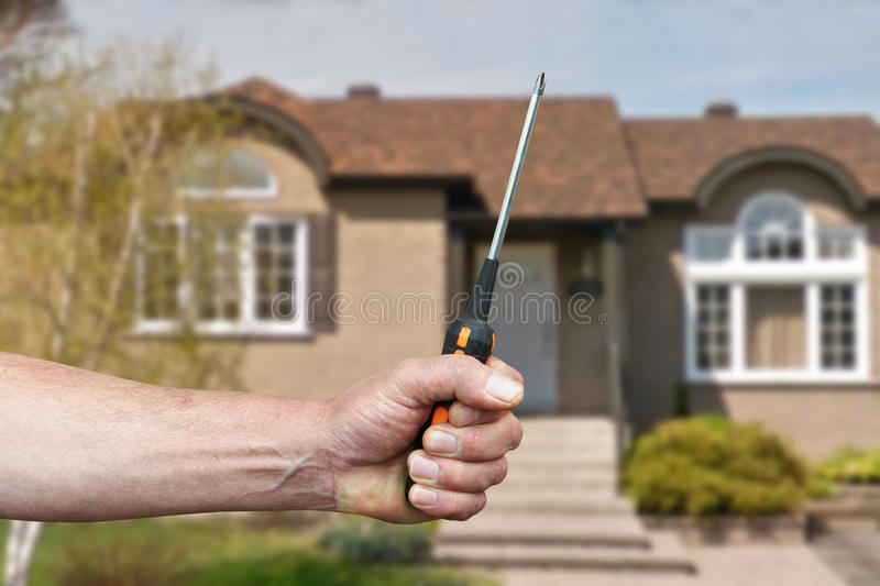 Hand of worker with screwdriver stock images