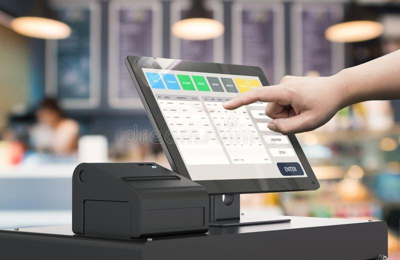 Hand working cashier machine. Human hand working with 3d rendering cashier machine stock image