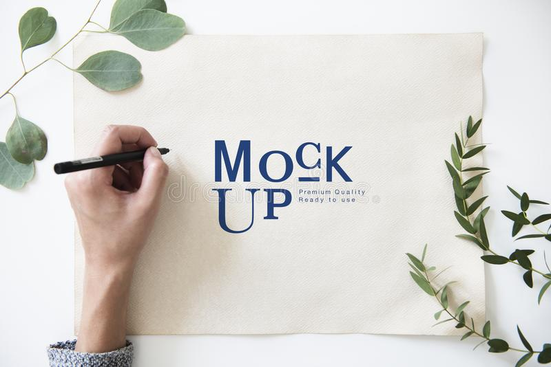 Hand working on paper mockup stock photos