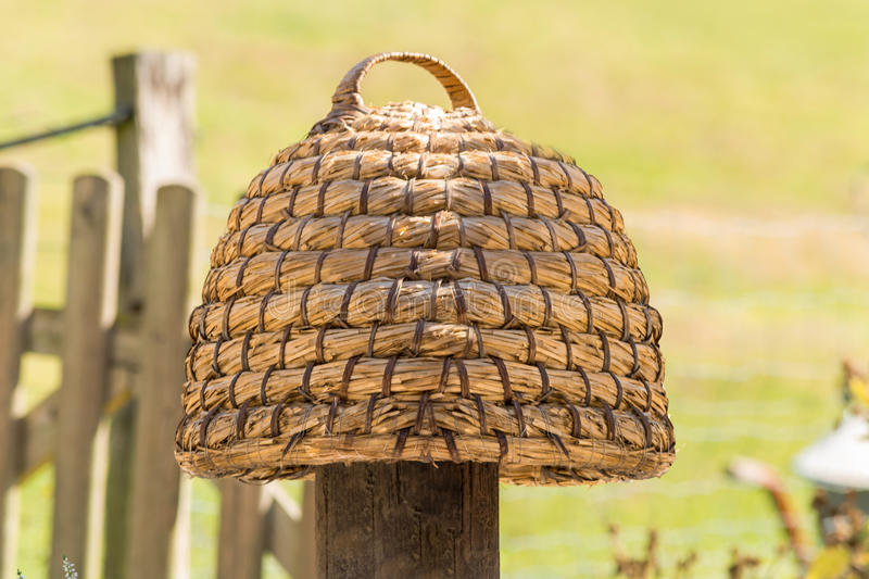 Hand woven hive made of straw. Age beehive, beehives of straw called basket Beekeeping is an ancient tradition stock photos