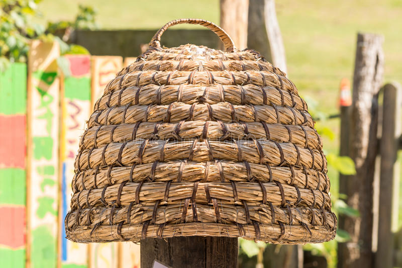 Hand woven hive made of straw. Age beehive, beehives of straw called basket Beekeeping is an ancient tradition stock photo