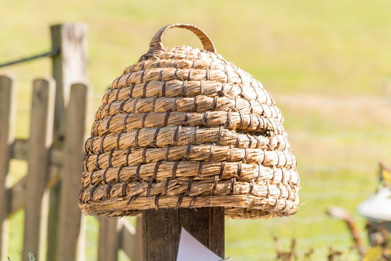 Hand woven hive made of straw. Age beehive, beehives of straw called basket Beekeeping is an ancient tradition stock photography