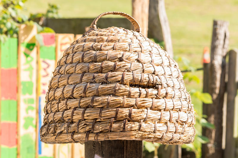 Hand woven hive made of straw. Age beehive, beehives of straw called basket Beekeeping is an ancient tradition royalty free stock image