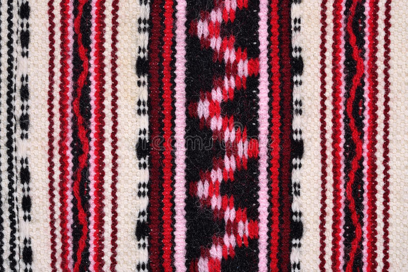 Hand woven patterned fabric. For background royalty free stock photos
