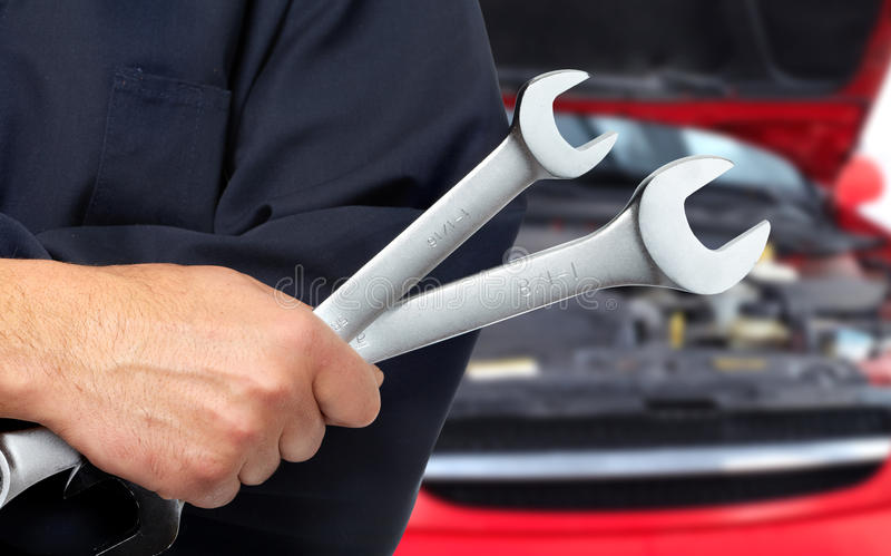 Hand with wrench. Auto mechanic. stock photo