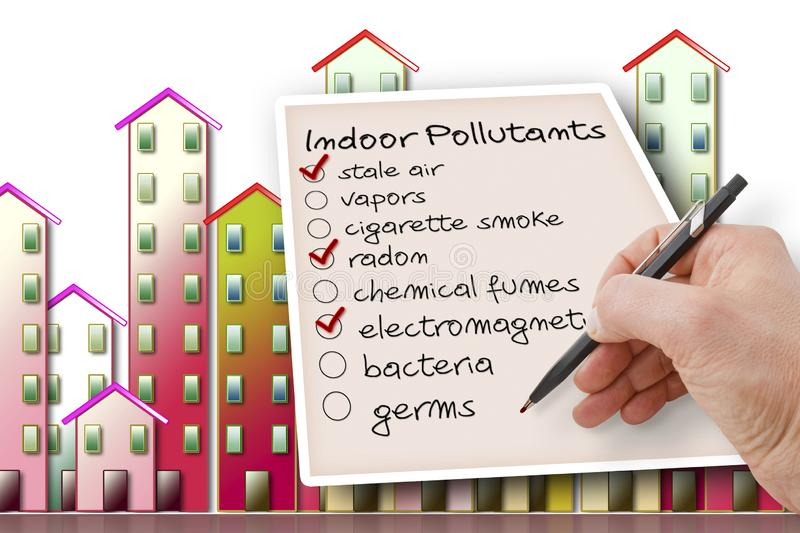 Hand write a check list of indoor air pollutants against a buildings background.  royalty free stock photography