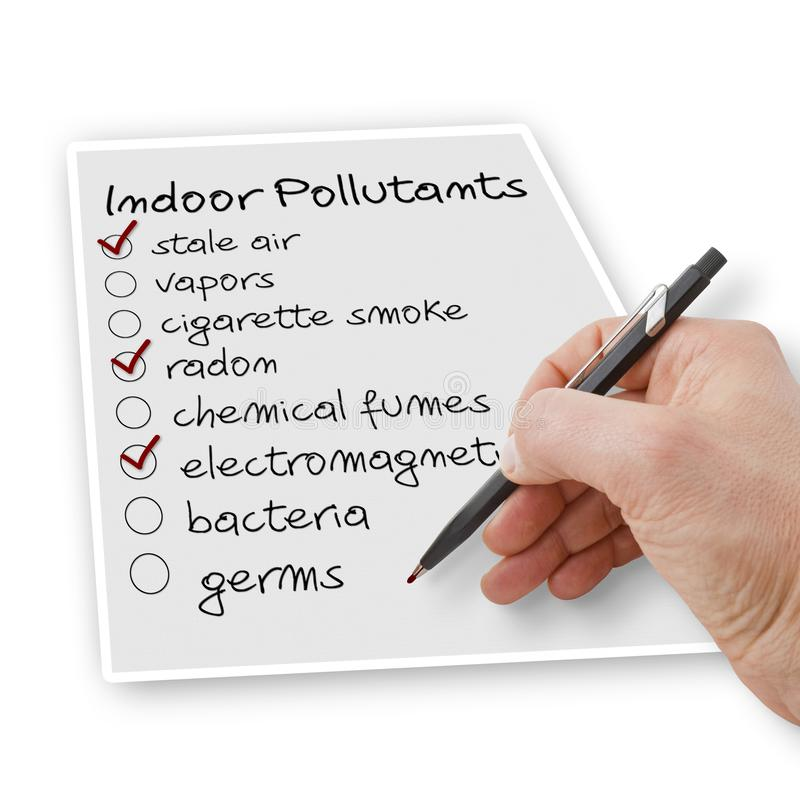 Hand write a check list of indoor air pollutants.  royalty free stock images