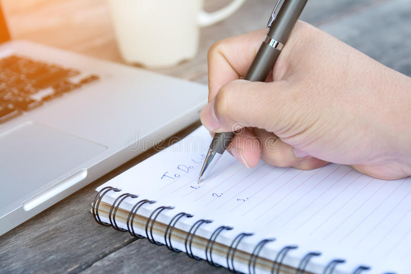 Hand write to do list on notebook stock photo