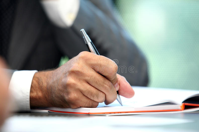 Hand writing. Businessman gesticulation in a conference stock photos