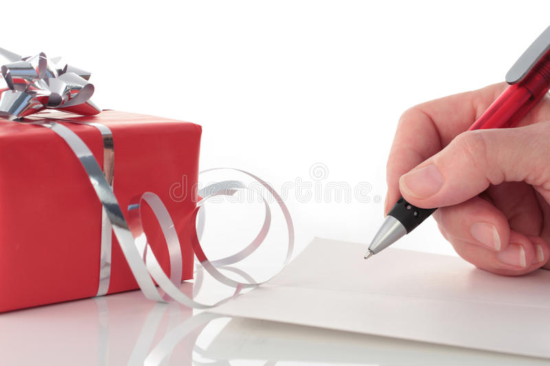 Hand Writing in Card by Red Valentines Day Gift royalty free stock image