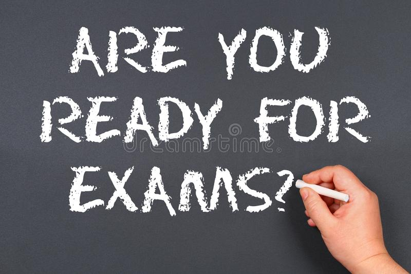 Hand writing chalk on a blackboard text: Are You Ready For Exam stock image