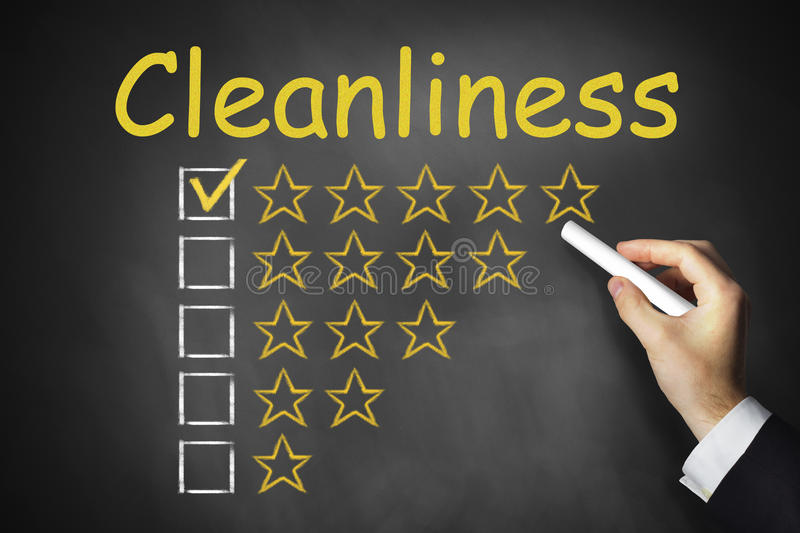 Hand writing cleanliness on chalkboard. Hand writing cleanliness on black chalkboard rating stars stock photos