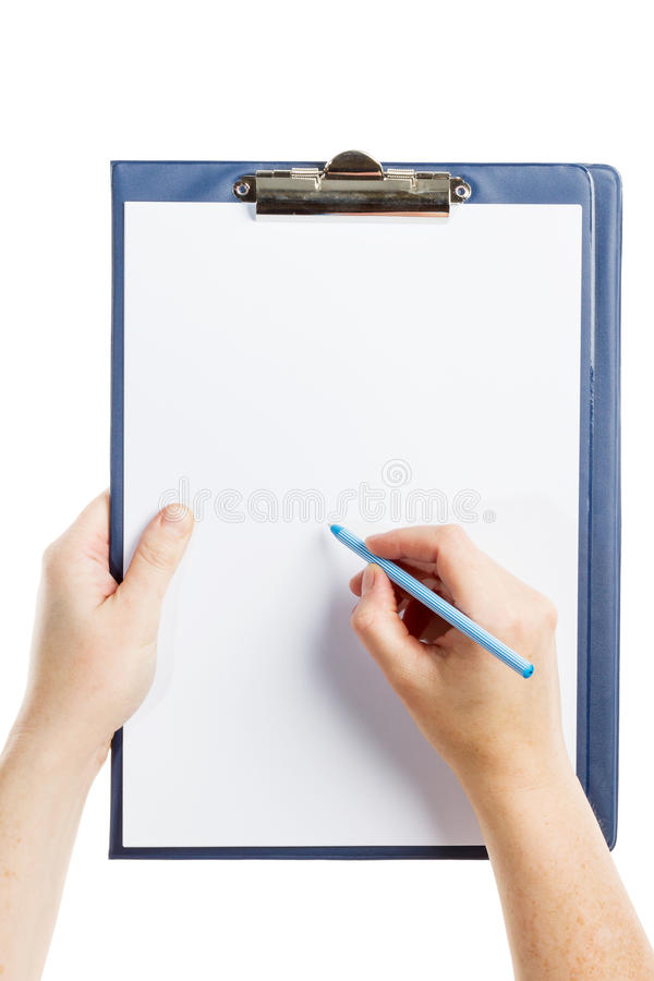 Hand writing on clipboard royalty free stock photography