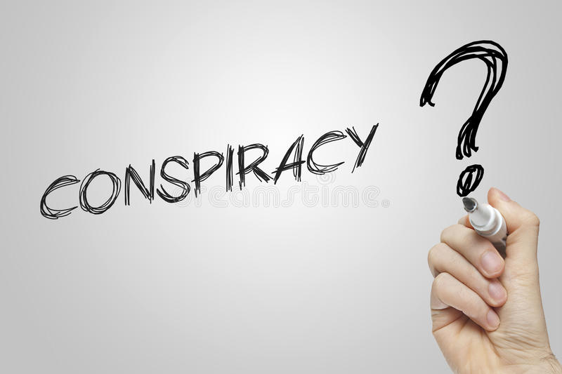 Hand writing conspiracy. On grey background royalty free stock photography