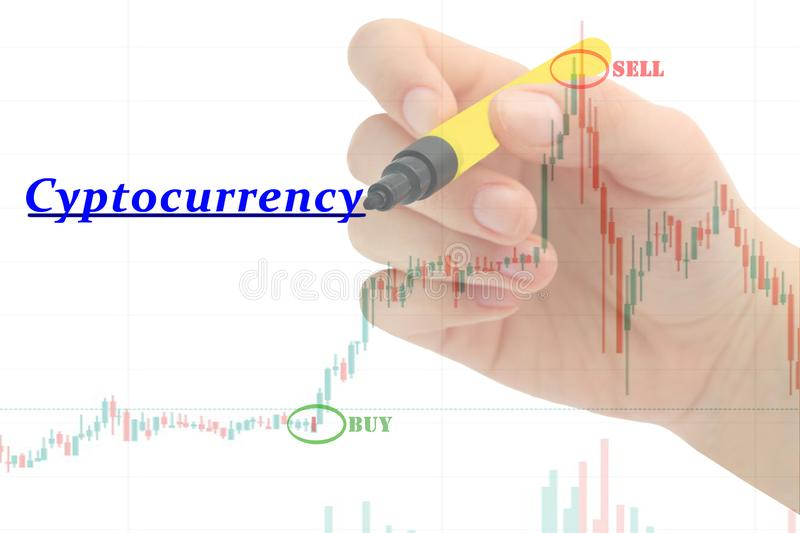 Hand writing `Cyptocurrency` on business graph and stock financial indicator. stock photography