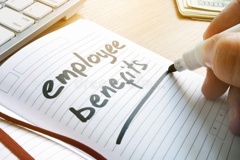 Hand is writing Employee benefits. stock photography
