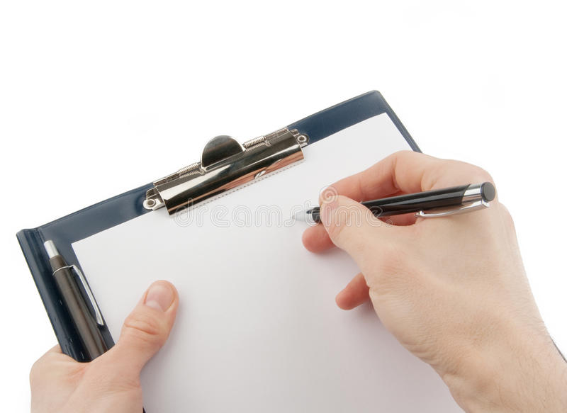 Hand writing on an empty document in a clipboard stock images