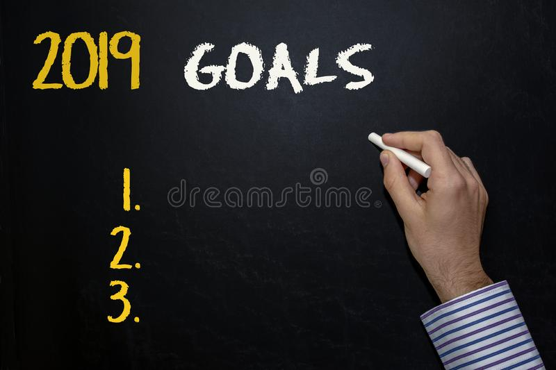 Hand writing Goals on the blackboard royalty free stock photos