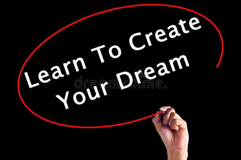 Hand Writing Learn To Create Your Dream. With a marker over transparent board royalty free stock photography