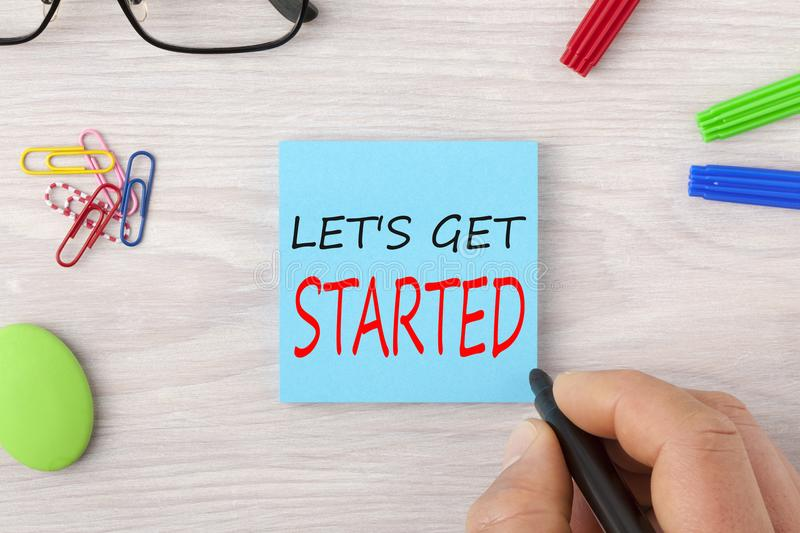 Let`s Get Started writing on note stock photos