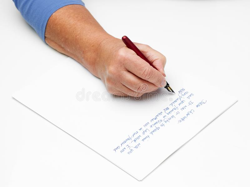 Hand and pen stock photography