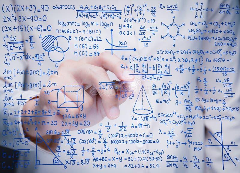 Hand writing math formula. On glass board stock photo
