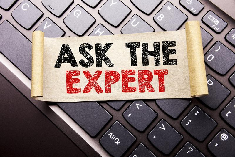 Hand writing text caption inspiration showing Ask The Expert. Business concept for Advice Help Question written on sticky note pap royalty free stock images