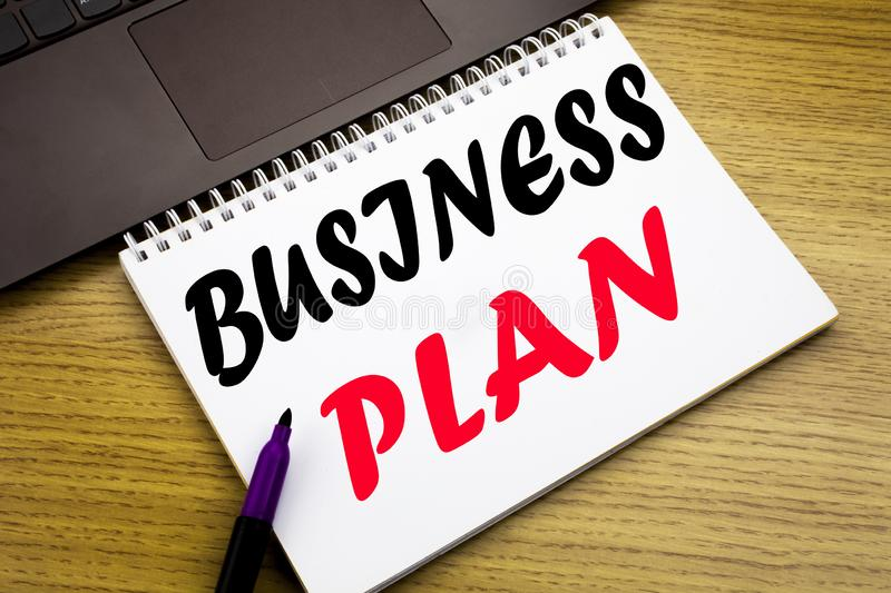 Hand writing text caption inspiration showing Business Plan Planning. Business concept for Preparation Project Strategy written on. Notebook book on wooden royalty free stock image