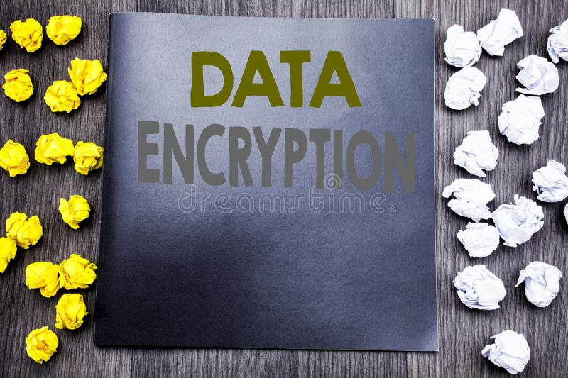Hand writing text caption inspiration showing Data Encryption. Business concept for Information Security Written on notepad note n. Otebook wooden background stock photos