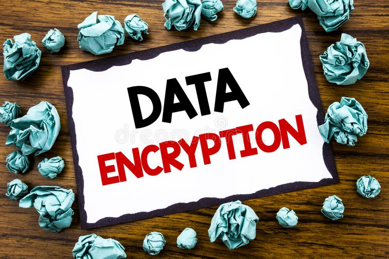 Hand writing text caption inspiration showing Data Encryption. Business concept for Information Security Written on sticky note pa. Per, wooden background folded royalty free stock photography