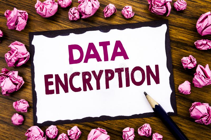 Hand writing text caption inspiration showing Data Encryption. Business concept for Information Security Written on sticky note pa. Per, wooden background folded stock image