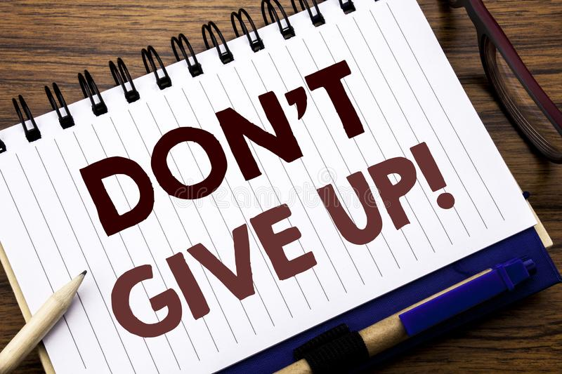 Hand writing text caption inspiration showing Don t Give Up. Business concept for Motivation Determination, Written on notebook no. Hand writing text caption royalty free stock photo
