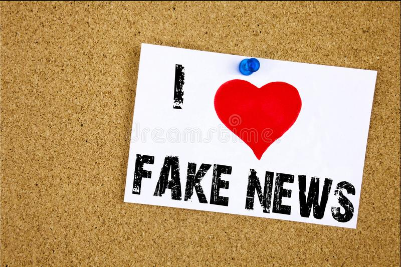Hand writing text caption inspiration showing I Love Fake News concept meaning Propaganda Newspaper Fake News Loving written on st stock photo