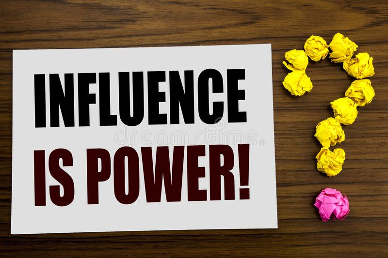 Hand writing text caption inspiration showing Influence Is Power. Business concept for Persuasion Strategy written on white note p royalty free stock photo