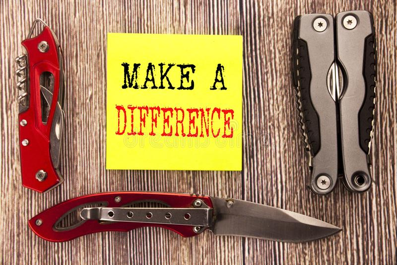 Hand writing text caption inspiration showing Make A Difference. Business concept for Motivation Success Written on sticky note wo stock images